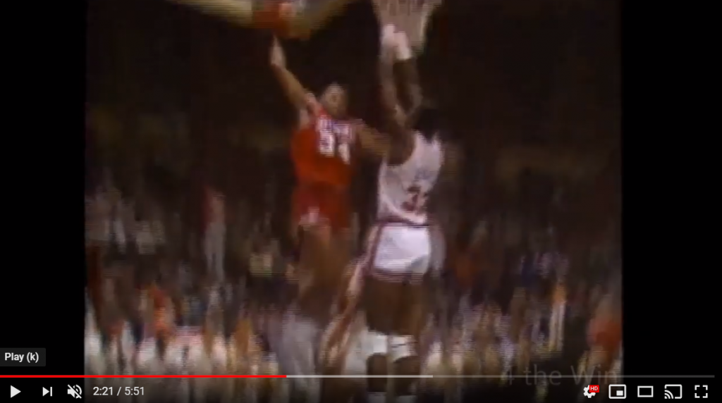 Charles Barkley dunking on Patrick Ewing