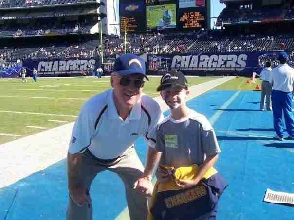 Marty Schottenheimer Poses With A Young Fan As Chargers Head Coach