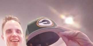 packers cheesehead on adult mans head