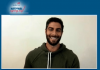 Jimmy Garoppolo Sitting in a chair and and abswering questions